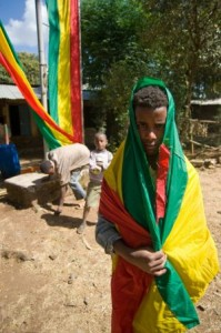 A boy in the Ethiopian Flag in Northern Ethiopia, Photo By Travis Horn